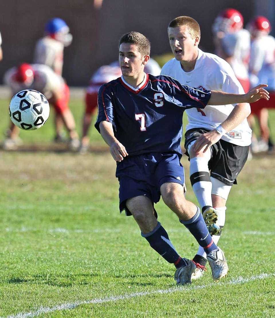Smithtown West forward Eddie Viscount #7 tries to