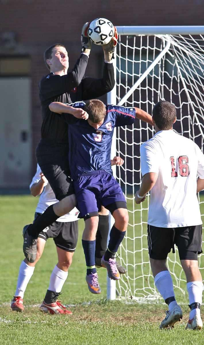 East Islip keeper Evan Maxwell grabs the shot
