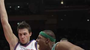 Boston Celtics' Paul Pierce, right, drives past New