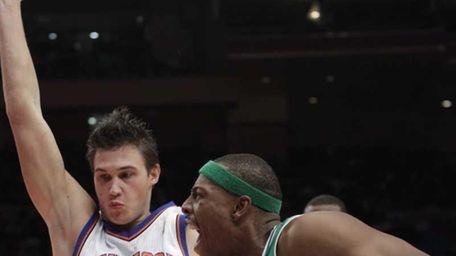 Boston Celtics' Paul Pierce, right, drives past New