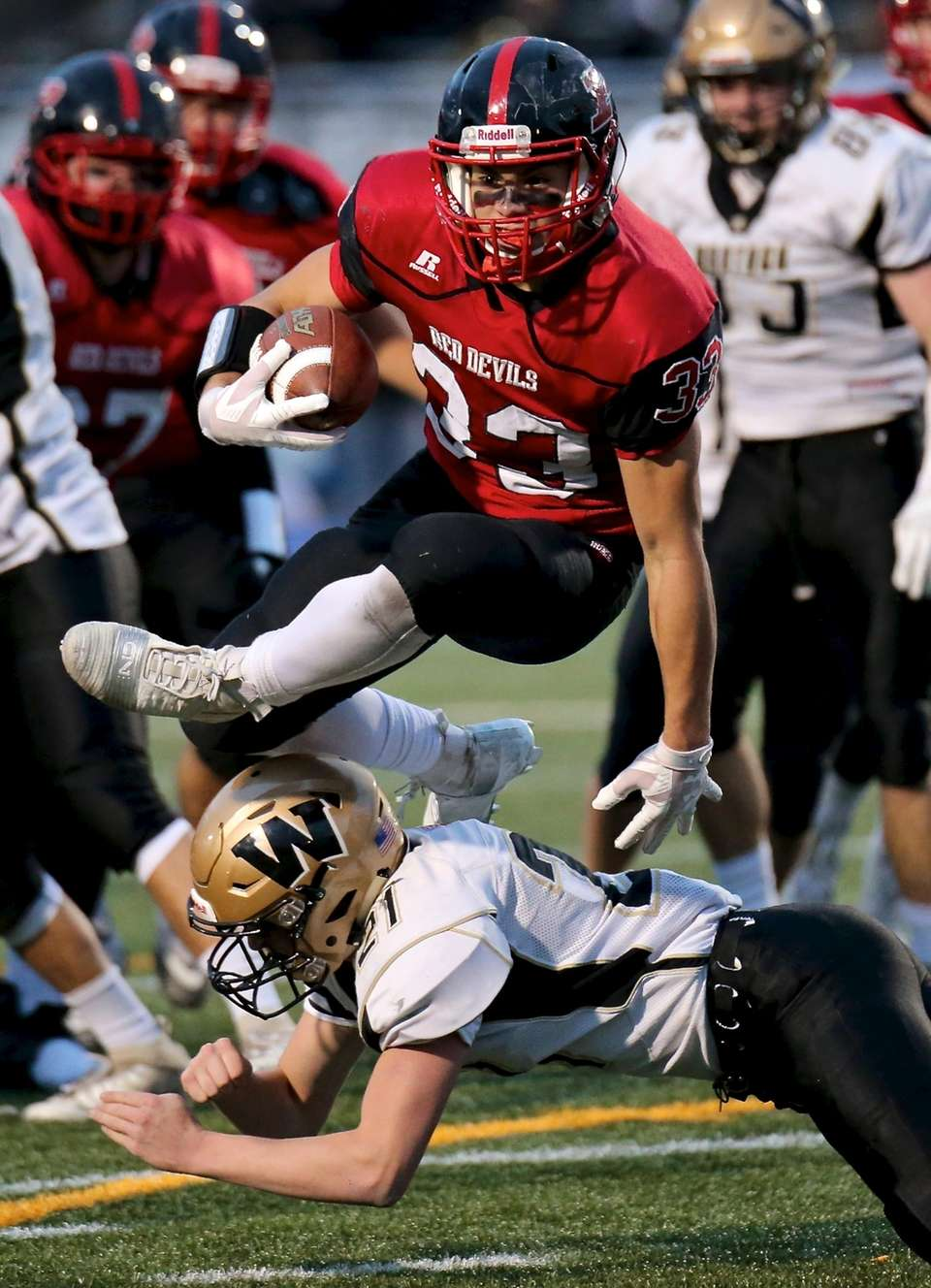Plainedge RB Dion Kuinlan leaps over the Wantagh