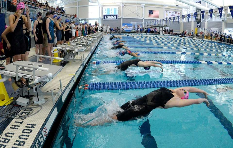 Sacred Heart Academy's Kaitlyn Devaney, bottom, swims in
