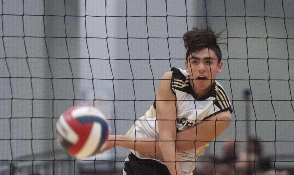 Sachem North's A.J. Fitzgerald spikes the ball to