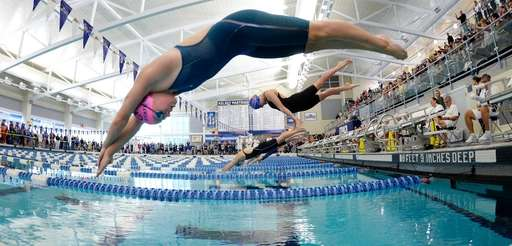 Sacred Heart Academy's Joan Cash, top, swims in