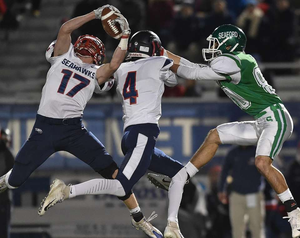 Daniel Striano of Cold Spring Harbor, left, intercepts