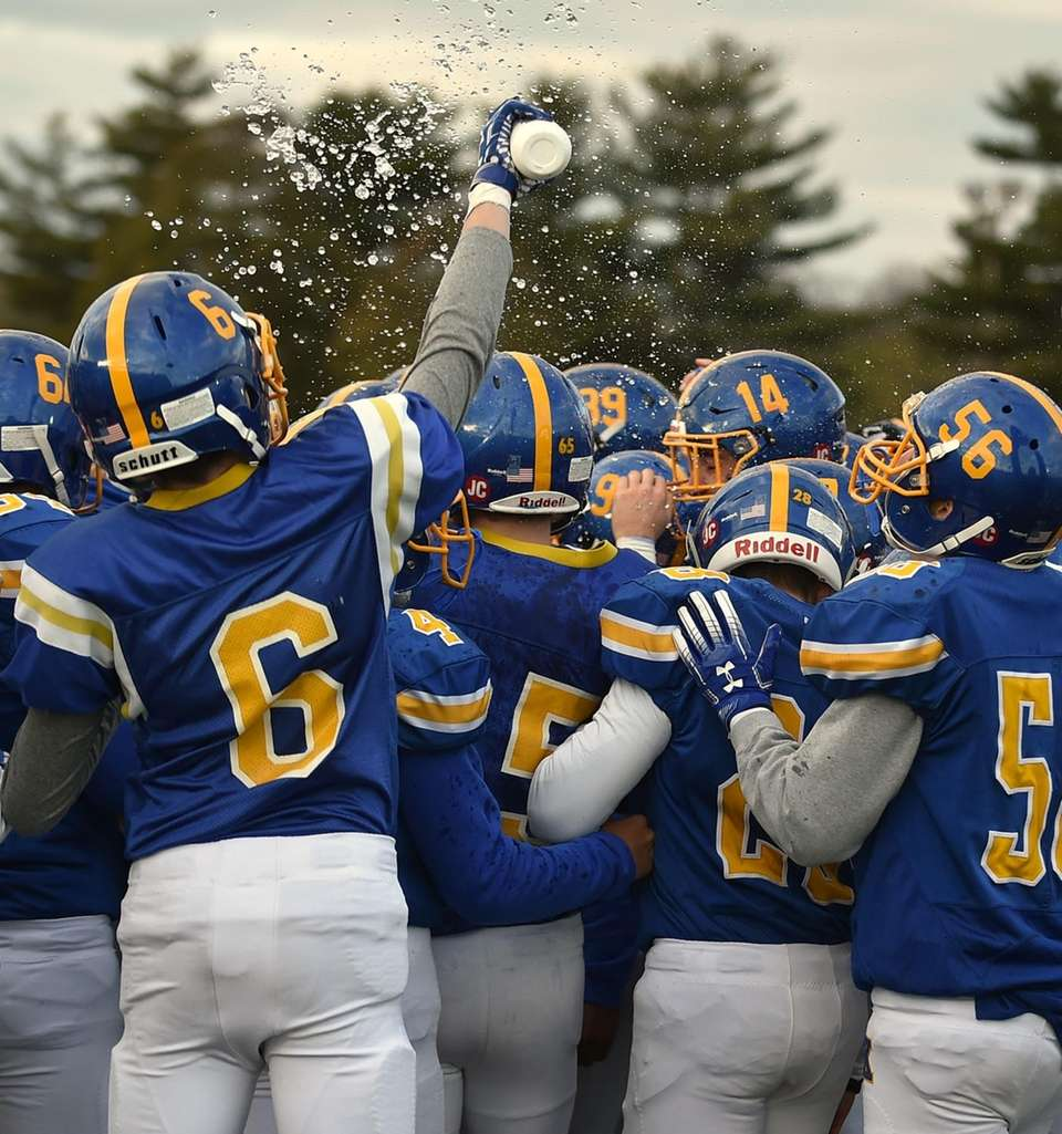 Kellenberg teammates celebrate after their 41-6 win over
