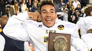 Shoreham-Wading River's Xavier Arline celebrates with the championship