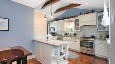 The kitchen in this Merrick expanded Cape listed