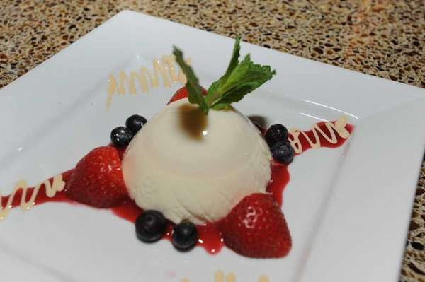Panna cotta with Cointreau-steeped berries is a tasty
