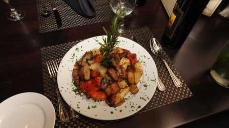 Chicken scarpariello, with sausage and potatoes, is one