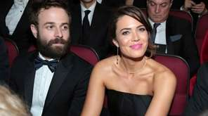Taylor Goldsmith, left, and Mandy Moore appear in