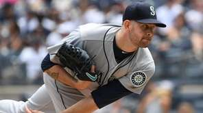 Mariners starting pitcher James Paxton delivers a pitch