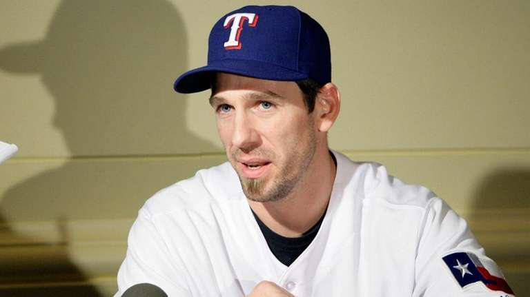 Cliff Lee speaks with the media.