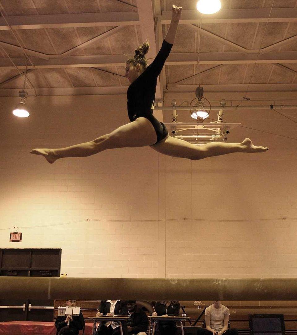 Commack's Jessica Burns flies high over the beam