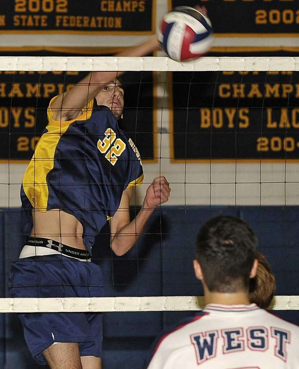 Northport's Matthew Lertora spikes the ball during his
