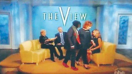 Joy Behar and Whoopi Goldberg walk off the