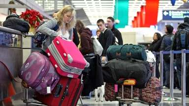 A traveler checks in at O'Hare International Airport