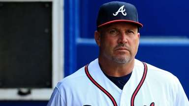 Fredi Gonzalez of the Atlanta Braves stands in