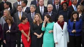 (L-R lower row, center) Representatives-elect Alexandria Ocasio-Cortez (D-NY),