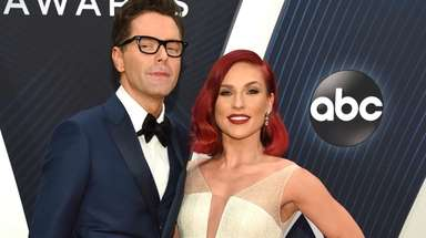 Bobby Bones, left, and Sharna Burgess arrive at