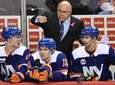Islanders coach Barry Trotz talks to some players