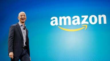 Amazon CEO Jeff Bezos walks onstage for the