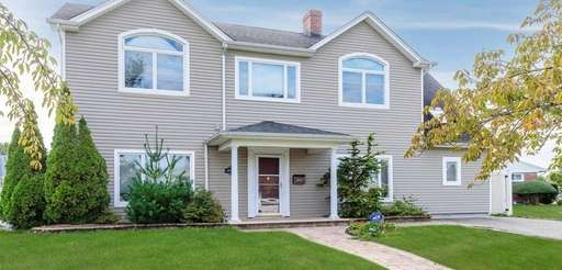 This Syosset Colonial includes four bedrooms and three
