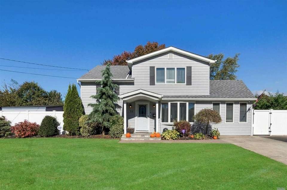 This East Islip split-level includes three bedrooms and