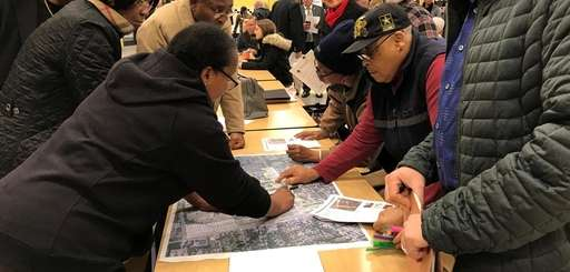 Central Islip residents go over a map of