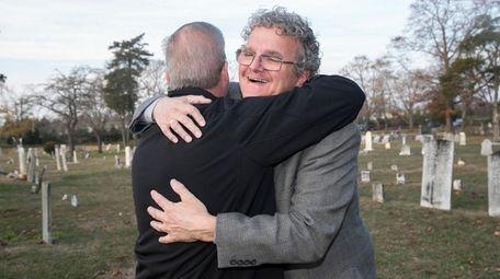 Roy Ruland of Oceanside, left, hugs Christopher Capobianco,