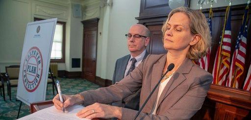 Nassau County Executive Laura Curran, with Assessor David