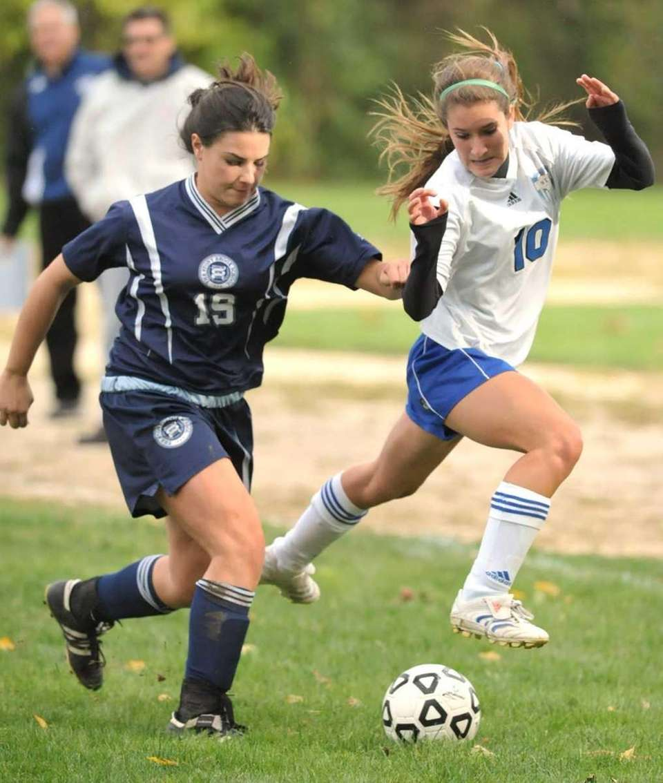 Smithtown Christian's Chelsea Bellini (10, right), fights for