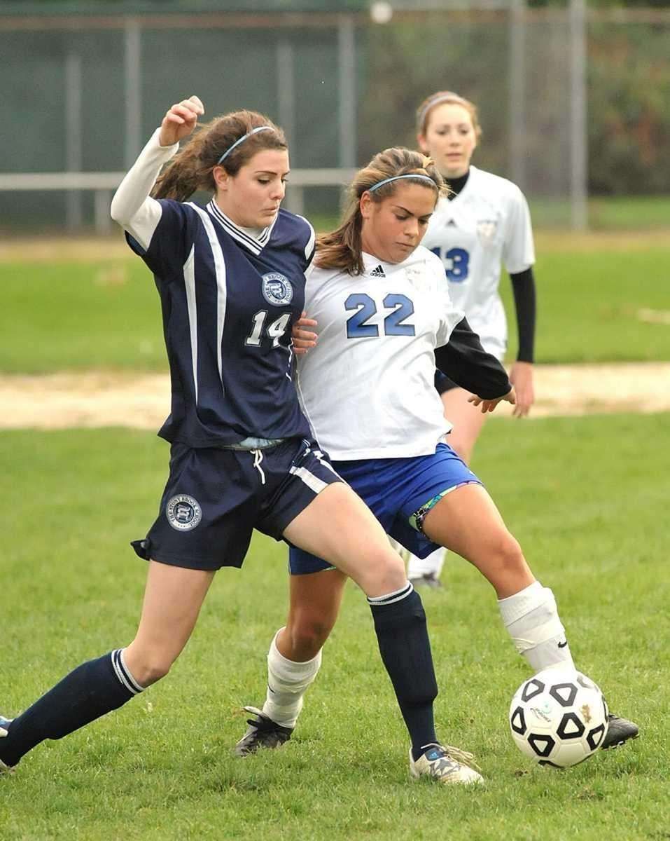 Smithtown Christian's Shannon Casey (22, right), fights for