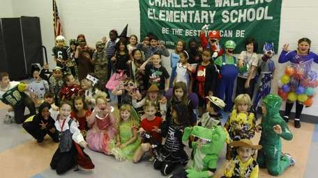 Second- and fourth-graders wear costumes for the Kidsday