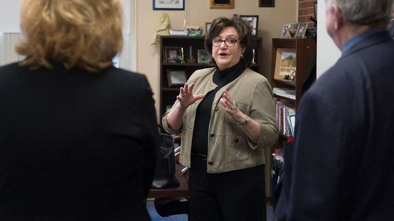 State Education Commissioner MaryEllen Elia, middle, said her