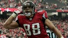 Falcons tight end Tony Gonzalez reacts after scoring