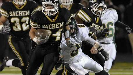 Sachem North's Dalton Crossan breaks a tackle by