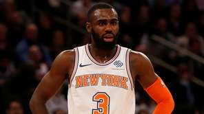 The Knicks' Tim Hardaway Jr. looks on in