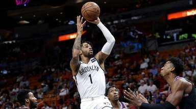 The Nets' D'Angelo Russell shoots over the Heat's