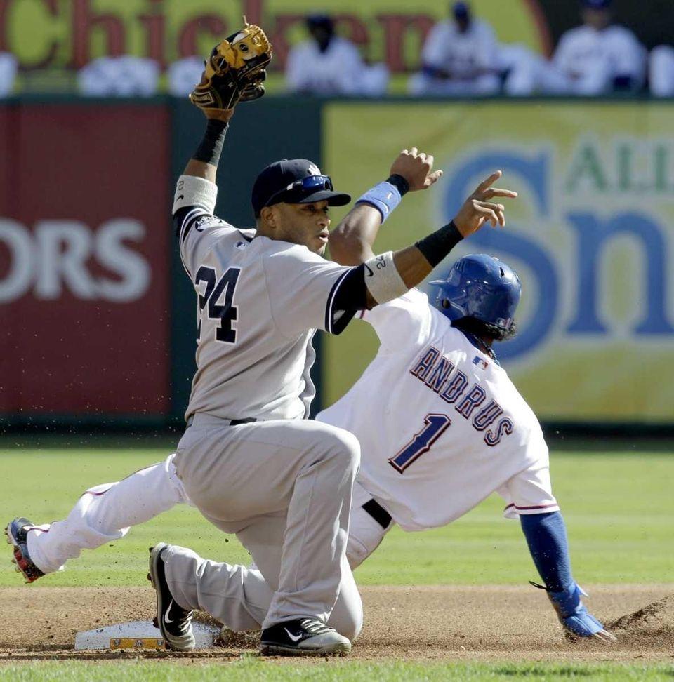 Texas Rangers' Elvis Andrus beats the throw to
