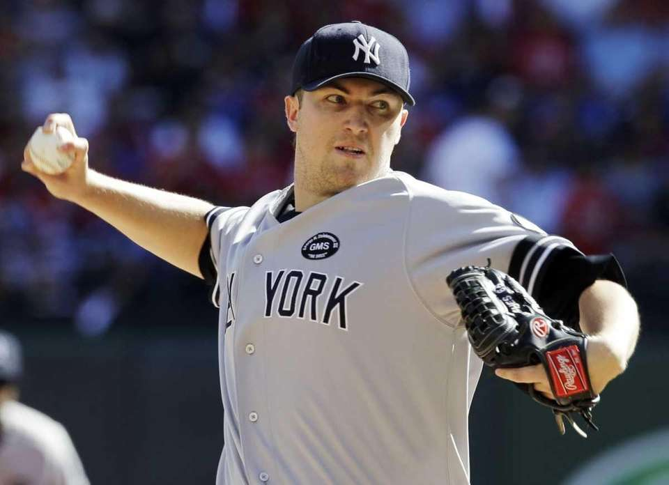 New York Yankees starting pitcher Phil Hughes delivers