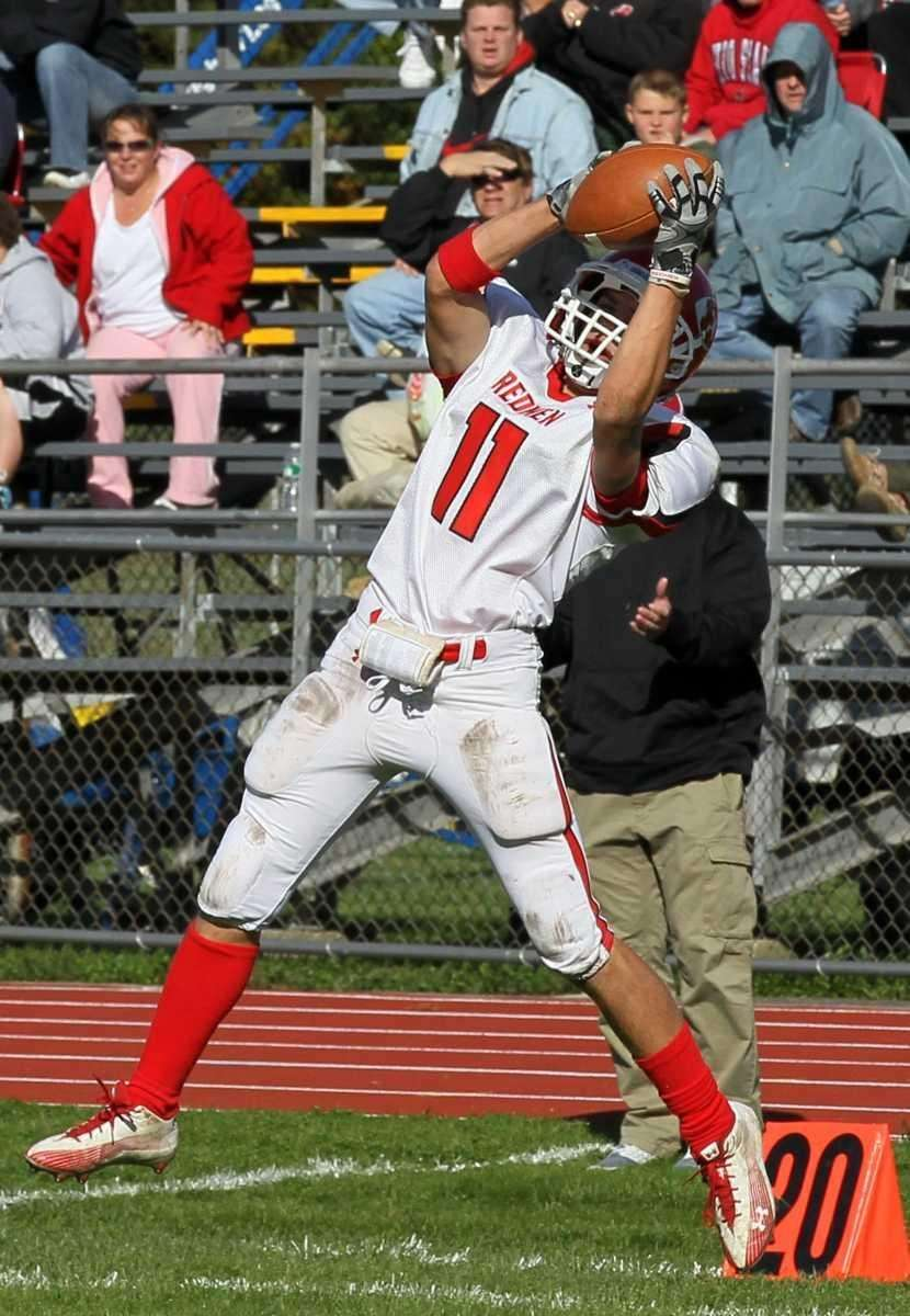Kyle Moller #11 of the East Islip Redmen