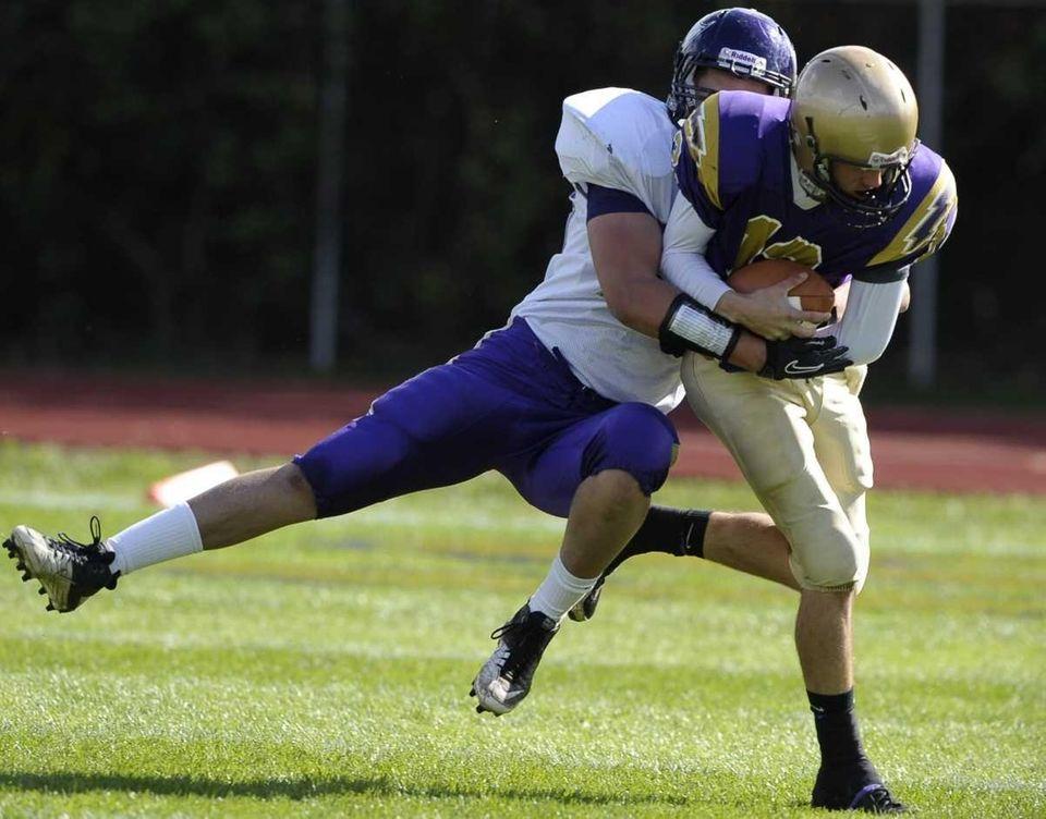 Islip's Andrew Oberg takes down Sayville quarterback Steven