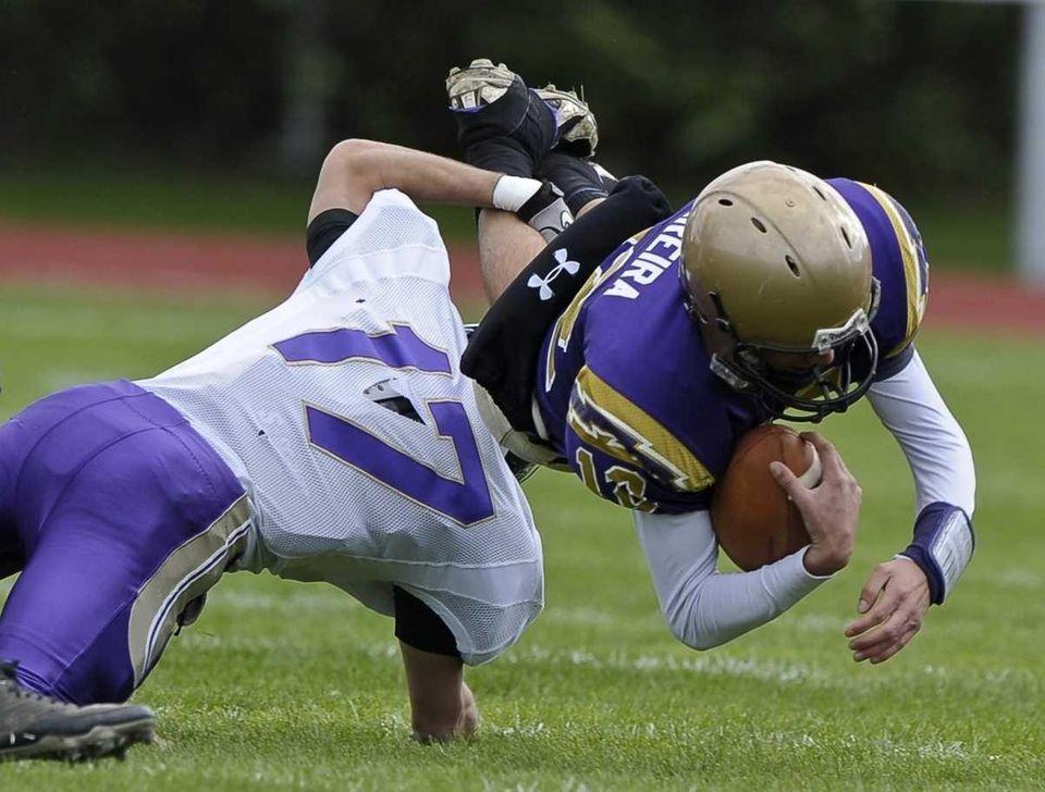 Islip's Joe Sciarra takes down Sayville quarterback Steven