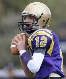 Sayville's Steven Ferreira looks to pass against Islip