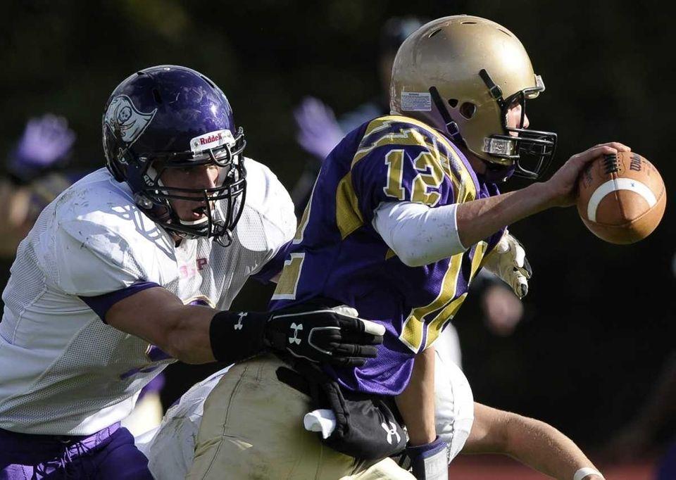 Islip's John Aubel tackles Sayville quarterback Steven Ferreira