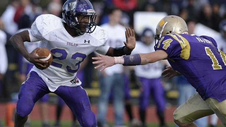 Islip's Jeffrey Craig looks to elude a tackle