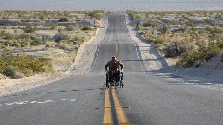 Gabriel Cordell rolls himself via an unmodified wheelchair