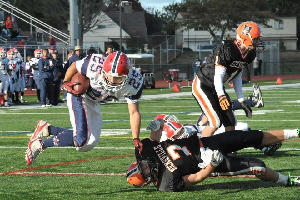 MacArthur's Nick Meadows (25, left), goes airborne to