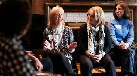 Barbara Denis, left, of Halesite introduces herself during